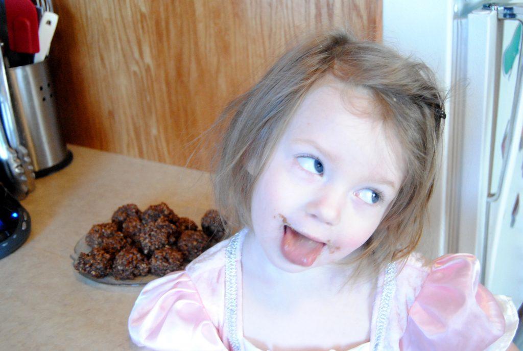 Eating chocolate coconut balls